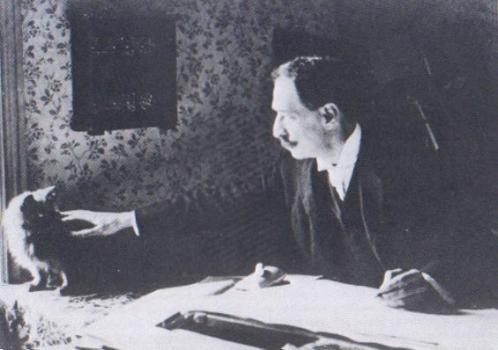 Louis Wain y un gato en 1890